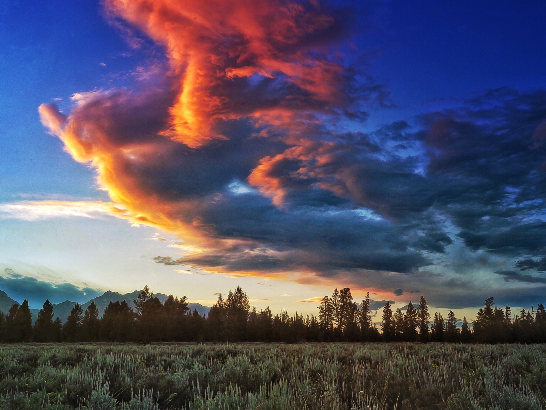 The Sun sets in the Tetons